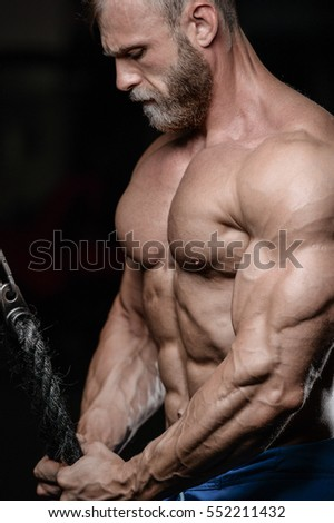 brutal muscular man with beard train in the gym unshaven fitness model healthcare lifestyle with topless body strong abs