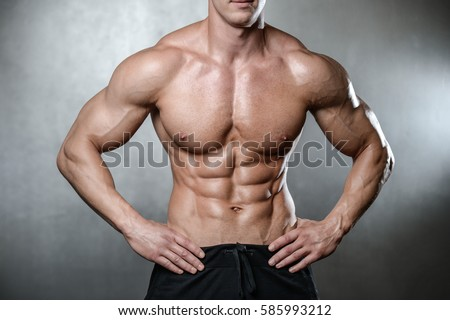 Brutal strong old bodybuilder man fitness male model posing in studio on white grey background topless body strong abs healthcare lifestyle diet in joy