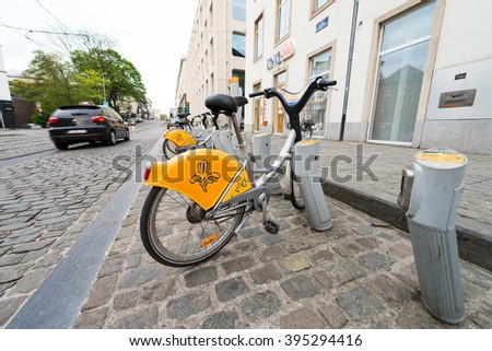 BRUXELLES - MAY 1, 2015: Public bike parking. Going by bike is a great way to enjoy the city. - stock photo