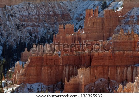 Bryce Canyon National Park is located on the Colorado Plateau in southern Utah/ Hoodoos/ Erosion patterns called hoodoos are created by water running on steep slopes along with freezing and thawing. - stock photo