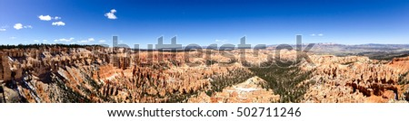 Bryce Point overlook panorama in Bryce Canyon National Park, Utah in bright blue sky and white cloud with sunshine.