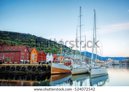 Bryggen street with boats in Bergen, UNESCO World Heritage Site, Norway