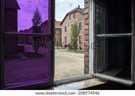 BRZEZINKA, POLAND - OCTOBER 13, 2012:  View from a window in Auschwitz Camp II, a former Nazi extermination camp. Auschwitz was a network of concentration camps built in Poland by Nazi Germany. - stock photo