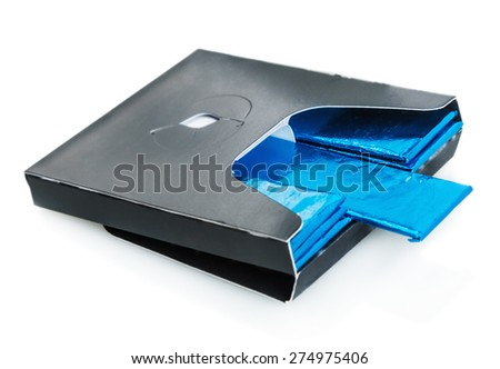 bubble gum deployed in standard blue packaging isolated. focus on chewing plate in the center, shallow depth of field - stock photo