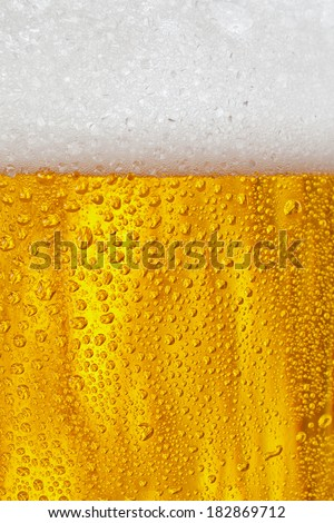 Bubbles and foam in a beer - stock photo