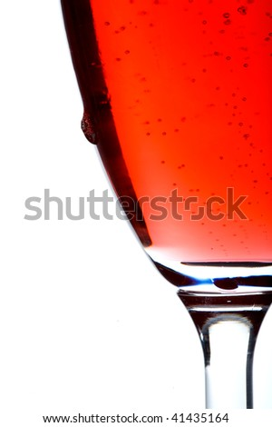 bubbles in a glass with a drop - stock photo