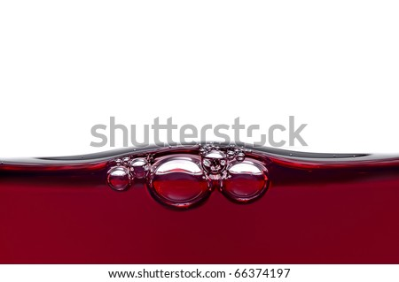bubbles in red wine - stock photo