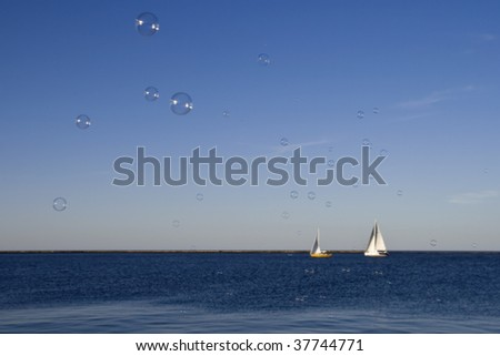 bubbles water boats - stock photo