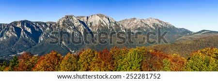 Bucegi Mountains, Romania. Autumn panorama scenery in Carpathian Mountains, sunrise on Bucegi ridge. - stock photo