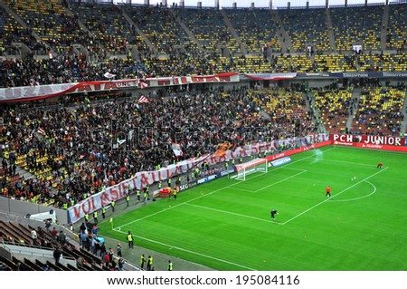 BUCHAREST - APRIL 17: Soccer supporters of Dinamo Bucharest during a match against Steaua Bucharest, in the National Arena stadium, final score: 1-1. On April 17, 2014 in Bucharest, Romania
