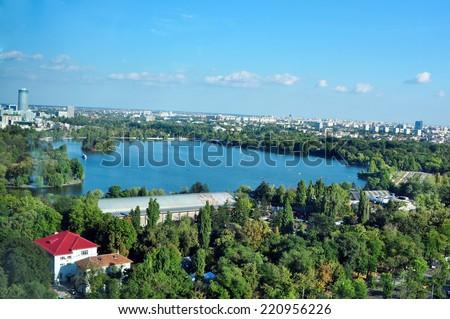 Bucharest city romania herestrau lake blue sky high angle view - stock photo
