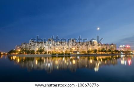 Bucharest night scene with Dambovita river and moon. Romania - stock photo