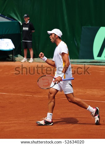 BUCHAREST, ROMAINIA  MAY 8: Romania's Horia Tecau cheers during the Davis Cup doubles match between Romania and Ukraine at the BNR Arenas on May 8, 2010 in Bucharest, Romania. - stock photo