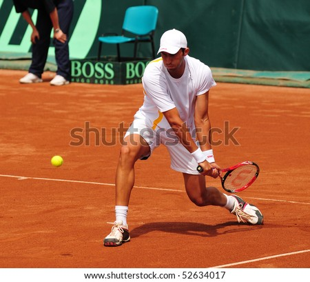 BUCHAREST, ROMAINIA  MAY 8:  Romania's Horia Tecau performs a backhand during the Davis Cup doubles match between Romania and Ukraine at the BNR Arenas on May 8, 2010 in Bucharest, Romania.