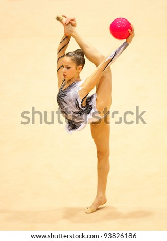 BUCHAREST, ROMANIA - APRIL 3: An unidentified gymnast performs during the Irina Deleanu Orange Trophy on April 3, 2011, Bucharest, Romania - stock photo