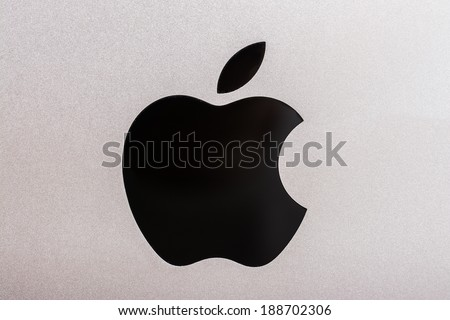 BUCHAREST, ROMANIA - APRIL 20, 2014: Apple Sign Close Up. Is an American corporation headquartered in Cupertino, that designs and sells consumer electronics, computer software and personal computers. - stock photo