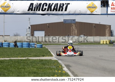 BUCHAREST, ROMANIA - APRIL 9: David Dugaesescu competes in National Karting Championship on April 9, 2011 in Bucharest, Romania.
