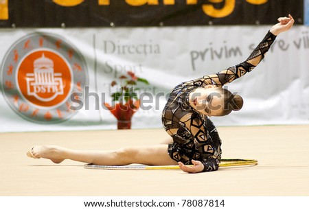 BUCHAREST, ROMANIA - APRIL 3: Unidentified gymnast performs during the Irina Deleanu Orange Trophy on April 3, 2011 in Bucharest, Romania - stock photo