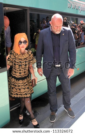 BUCHAREST, ROMANIA - AUGUST 15: American singer Lady Gaga arrives at the Hilton Bucharest, Aug 15, 2012. Lady Gaga will perform a concert in Constitution Square in Bucharest, Thursday, August 16. - stock photo