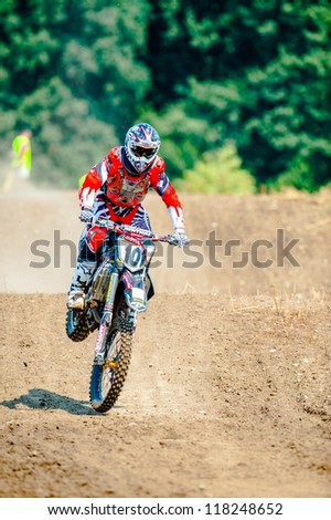 BUCHAREST, ROMANIA - AUGUST 25: An unidentified rider participates in the Fourth National Endurocross Championship on August 25, 2012 at Dragomiresti Deal in Bucharest, Romania