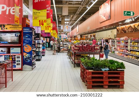 BUCHAREST, ROMANIA - AUGUST 10, 2014: People Shopping For Bread Products In Supermarket Store Aisle. - stock photo