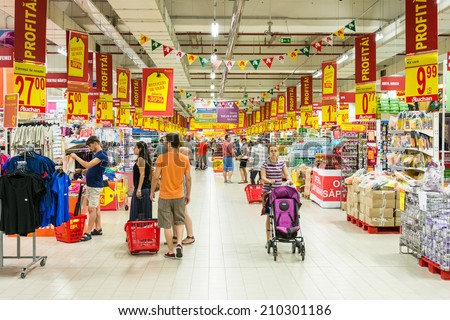 BUCHAREST, ROMANIA - AUGUST 10, 2014: People Shopping In Supermarket Store Aisle. - stock photo