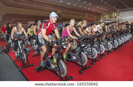 BUCHAREST, ROMANIA - AUGUST 20, 2013: Spinning marathon challenge. Charity sport event organized by World Master Class, on August 20, 2013, in Romexpo at Bucharest, Romania. - stock photo