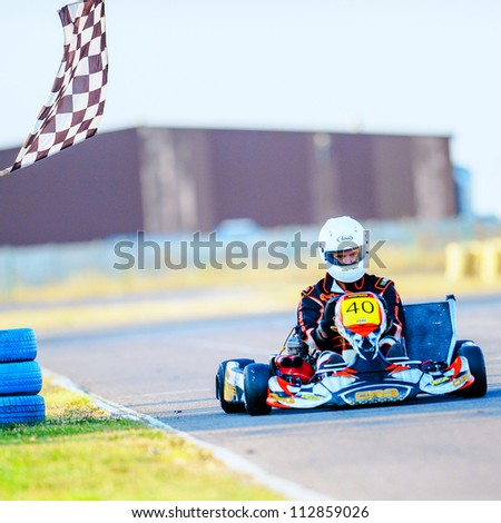 BUCHAREST, ROMANIA - AUGUST 4: Unknown pilot competing in National Karting Championship 2012 at Amkart Bucharest, on August 4, 2012 in Bucharest, Romania - stock photo