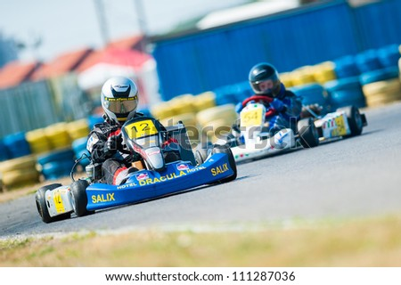 BUCHAREST, ROMANIA - AUGUST 4: Unknown pilots competing in National Karting Championship 2012 at Amkart Bucharest, on August 4, in Bucharest, Romania - stock photo