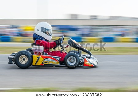 BUCHAREST, ROMANIA - AUGUST 4: Unknown pilots competing in National Karting Championship 2012 at Amkart Bucharest, on August 4, 2012, in Bucharest, Romania - stock photo