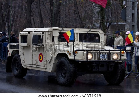 BUCHAREST, ROMANIA-DEC. 1: Military Parade on National Day of Romania, Arc de Triomphe, December 1, 2010 in Bucharest. - stock photo