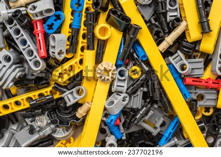 BUCHAREST, ROMANIA - DECEMBER 14, 2014: Lego Technic Pieces Pile Close Up. Technic is a line of Lego interconnecting plastic rods and parts that creates more advanced models with complex movable arms. - stock photo