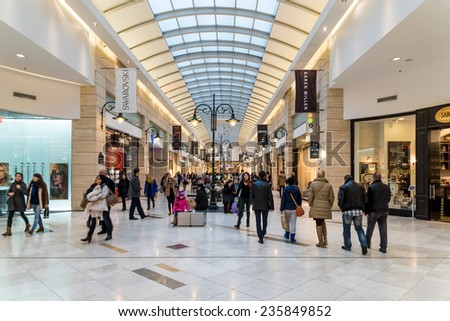 BUCHAREST, ROMANIA - DECEMBER 01, 2014: People Shopping For Christmas In Luxury Shopping Mall Interior. - stock photo