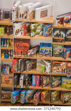 Bucharest, Romania - February 10, 2016: Board games on shelves in a public library.