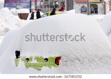 BUCHAREST ROMANIA - February 14: Weather anomalies covers all the city with snow, cars are trapped in snow February 14, 2012 in Bucharest, Romania - stock photo