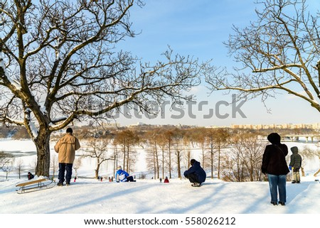 BUCHAREST, ROMANIA - JANUARY 11, 2017: Children Playing With Snow After Snowfall On Winter Day In Tineretului Park Of Bucharest.