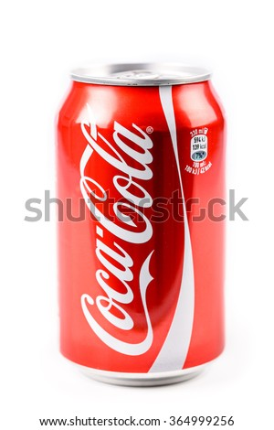 BUCHAREST, ROMANIA - JANUARY 16, 2016: Coca-Cola is a famous carbonated soft drink sold in stores, restaurants, and vending machines around the world. - stock photo