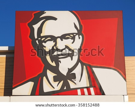BUCHAREST, ROMANIA - JANUARY 5, 2015. Colonel Sanders, the the official face of Kentucky Fried Chicken logo. KFC is a fast food restaurant chain that specializes in fried chicken.