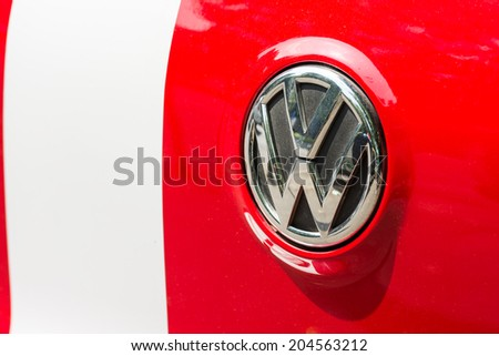 """BUCHAREST, ROMANIA - JULY 10, 2014: Volkswagen was founded in 1937 and is a German automobile manufacturer headquartered in Wolfsburg, Germany and means """"people's car"""" in German. - stock photo"""