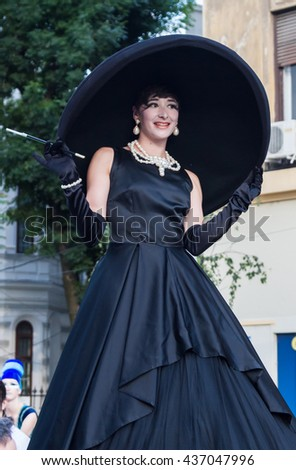 "BUCHAREST, ROMANIA - JUNE 09, 2016: Audrey Hepburn & Poodle Lulu street theater show (Germany), inside of International Festival of Street Theater, ""B-FIT in the street 2016"" - stock photo"