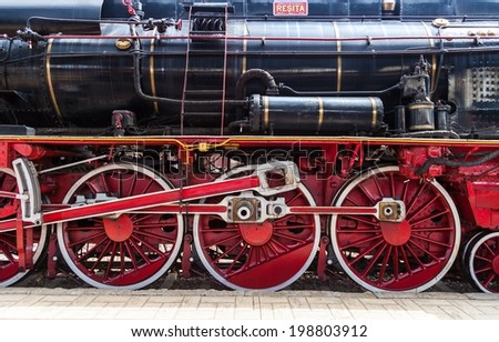 BUCHAREST, ROMANIA - JUNE 11, 2014: Detail of the wheels of a steam locomotive produced in Resita and exposed a few days inside the largest stations in Romania - Gara de Nord in Bucharest - stock photo