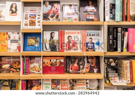 BUCHAREST, ROMANIA - JUNE 03, 2015: Food Cooking Books For Sale On Modern Bookstore Shelf.