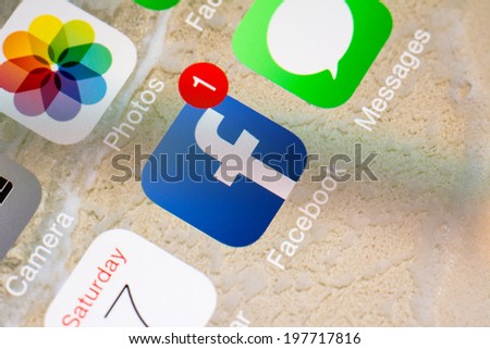 BUCHAREST, ROMANIA - JUNE 07, 2014: Notification On Facebook Application On Apple iPhone 5S. Founded in 2004 Facebook is an online social networking service with more than 1.3 billion users worldwide. - stock photo