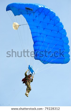 BUCHAREST, ROMANIA - JUNE 4: Paratroopers from National Skydiving Club at Transilv Aero Show 2011 in Clinceni on June 4, 2011 on Bucharest, Romania - stock photo