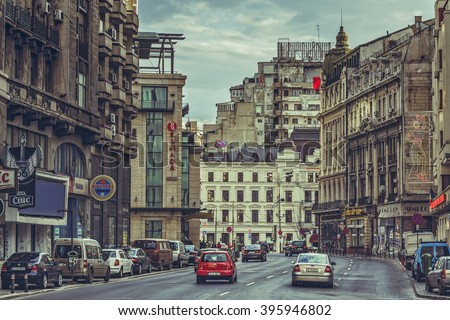Bucharest, Romania - March 16, 2014: Cityscape with Victory Avenue (Calea Victoriei), a major avenue in central Bucharest, lined with fashion shops, art boutiques, hotels and restaurants.
