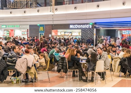 BUCHAREST, ROMANIA - MARCH 03, 2015: People Eating Fast-Food From McDonalds Restaurant In Shopping Mall. - stock photo