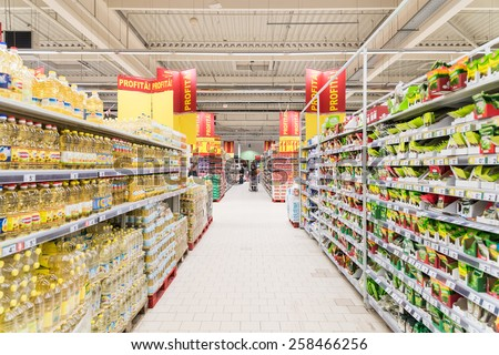 BUCHAREST, ROMANIA - MARCH 01, 2015: People Shopping In Supermarket Store Aisle. - stock photo