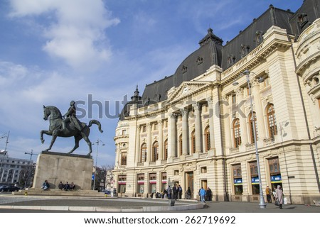 Bucharest, Romania - March 02, 2015: The Central University Library on March 02, 2015.The building is located in central Bucharest with statue of Carol I, first king of Romania in front.