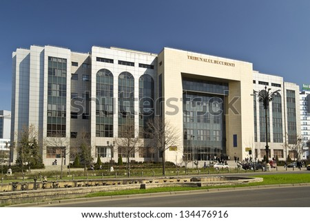 BUCHAREST, ROMANIA - MARCH 27: The Courthouse facade on March 27, 2012 in Bucharest, Romania. It was inaugurated in 2009 and has 27.000 square meters and 8 floors (2 floors are situated underground). - stock photo