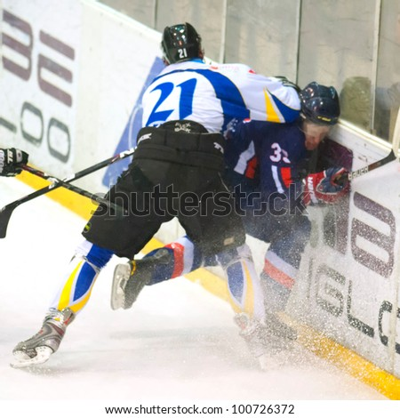 BUCHAREST, ROMANIA - MARCH 2: Unidentified hockey players fight during the Steaua Rangers vs Corona Brasovl game at Flamaropol Stadium, score 3-2, on March 2 , 2012 in Bucharest, Romania - stock photo